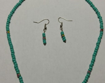 Simple blue beaded necklace and earrings