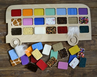 Sensory game. Bus with tactile material. Game for children