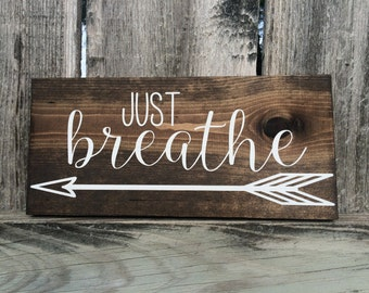 Just Breathe Arrow on Stained wood