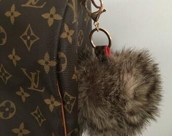 "Giant XXL (4"" diameter) faux fur pom- upcycled LV canvas"
