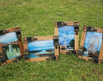 Up-cycled picture frames, decorated with buckles.