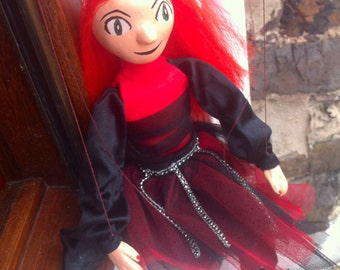 Puppet woman red fire