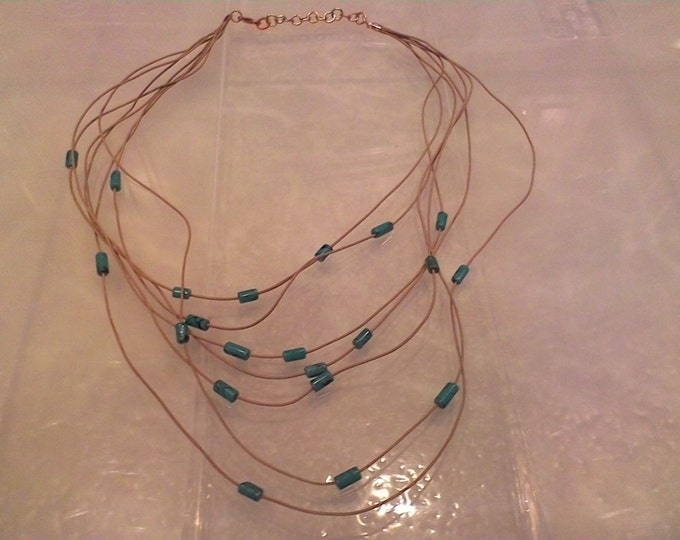 tan leather cord necklace with turquoise beads