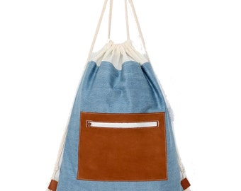 MUUTEN NAHKA / / gym bags made of denim and leather