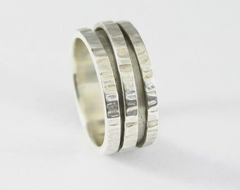 Eveline  - Handmade wide line hammered sterling silver spinning ring