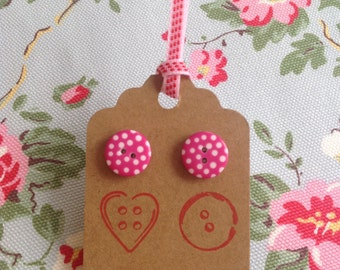 Pink spotty button earrings.
