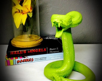 striking coiled snake statue hand painted bright green tabletop replica rattlesnake