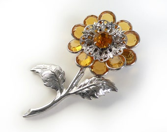 1960's vintage flower brooch with topaz crystal stones in channel settings