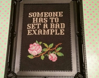 Someone has to set a bad example. Finished and framed cross stitch.