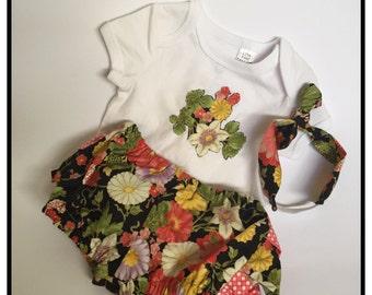 Black floral rufflebum shorts, onesie and headband