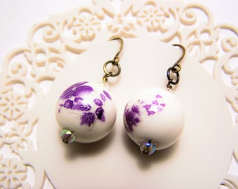 unique earrings with brass earwires and ceramic bead with purple flower design