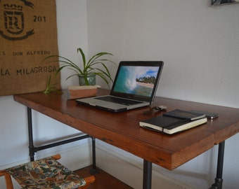 Reclaimed wood desk with Cast iron legs