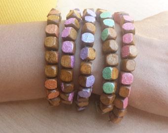 Wooden bracelet with metallic color