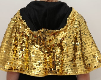Sequined gold capette with black velvet lining