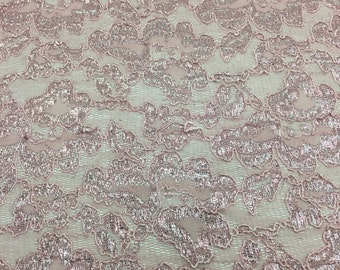 4 way stretch metalic lace dusty rose with scallop edge on both sides