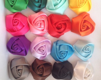 16 x 2inch satin rosettes, colours as pictured, has a felt glue pad on the back. DIY headbands,accessories, scrapbooking, craft
