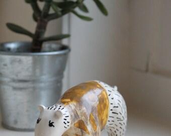 Orange jacket ceramic bear