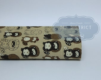 Japanese Tanuki beige background fabric.