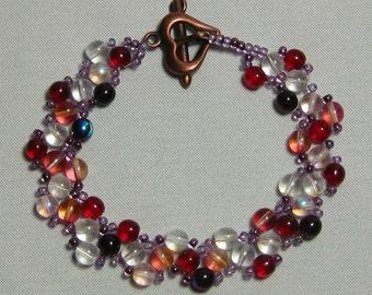 Red/pink cross needle weave bracelet