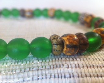Bohemian Glass and Metal Objects Necklace // Trade Beads and Picasso Beads // Green, Brown, Yellow and Silver Accessory