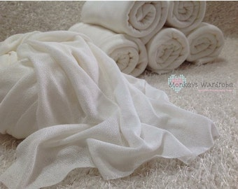 Ivory sheer stretchy wrap with unfinished edges.