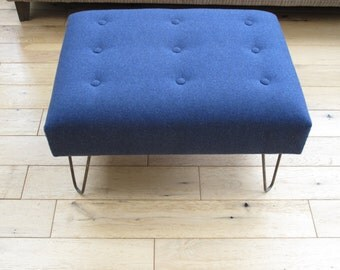 Contemporary handcrafted footstool with luxurious blue Warwick Wool fabric and shallow buttoning