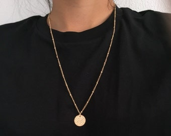 Long necklace with disc pendant