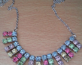 silver coloured necklace with multi coloured stones
