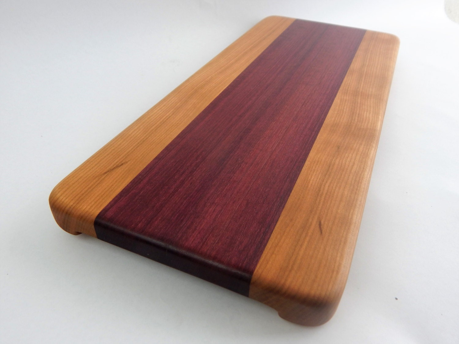 Handcrafted wood cutting board edge grain cherry heart
