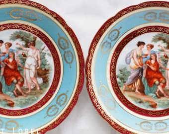 Pair of wonderful Victoria China Czechoslovakia cabinet plates with allegorical theme aquablue and burgundy colors, goldcolored ornate décor