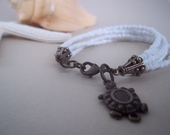 Turtle or Clam Charm Bracelet with White Beads