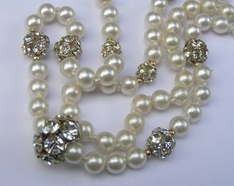 Vintage Long Faux Pearl - Rhinestones Ball Necklace - Costume jewelry  .