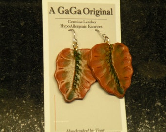 Hand carved leather earrings
