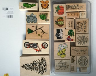 Wood mounted rubber stamps; lot of 24