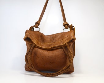 Large leather fold over bag with interchangable strap
