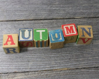 AUTUMN spelled out in vintage ABC blocks, 1-1/4 inch vintage wooden blocks