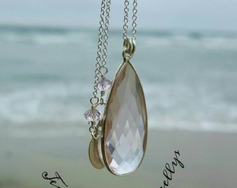 Faceted Rose Quartz and Sterling silver pendant!