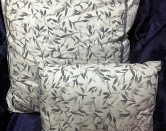 A Set of Two Grey Glistening Decorative Pillows- Small and Large