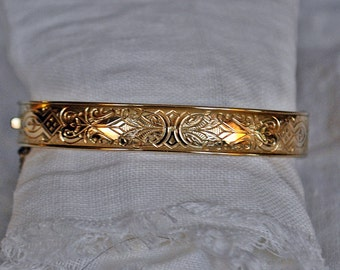 Gold bangle with etchings