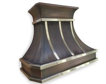 Copper range hood with stainless steel straps and decorative molding