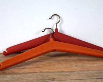 Plastic hanger from the 70's, retro, vintage orange