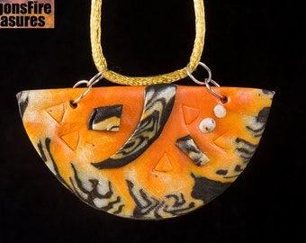 Orange and black polymer clay pendant