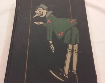 Vintage 1926 Third Edition of The Adventures of Pinocchio by C. Collodi. Color Illustrations by Attilio Mussino . Printed in Italy.