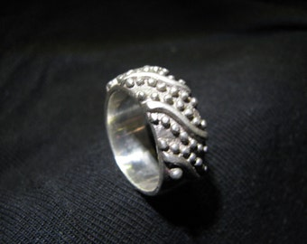 Chunky silver ring with unusual ball design