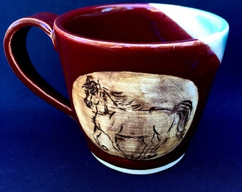 Horse Coffee mug with red, white, and celadon glazes