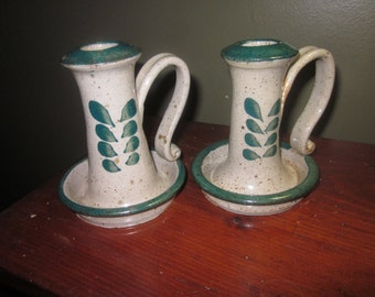 2 stoneware candles holders