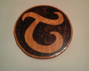 "Script ""T"" on Circular Wood Plaque"