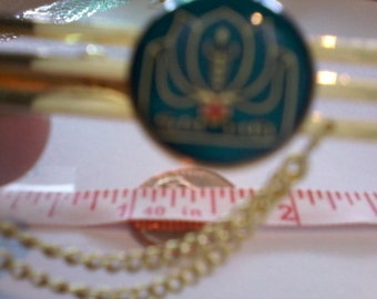 Strange Lotus Flower or Unknown with Unknown Writing Tie Bar with Two Chains
