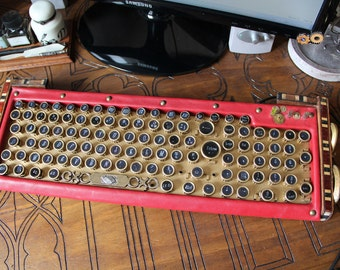 Steampunk computer keyboard, victorian style, red and gold, leather, wood, metal