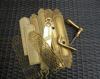 A collection of brass door furniture